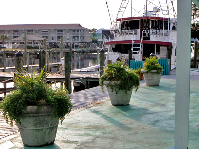 To the left you'll see the charter boats docked and ready for your Gulf Shores deep sea fishing expedition.