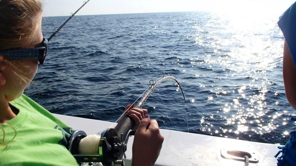 Girl fishing charter florida for Deep sea fishing orange beach
